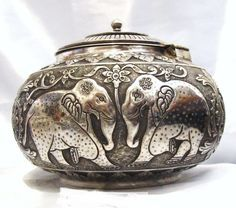 Antique Solid Silver Persian/Indian lidded box, early 1900's. Adorned with beautiful foliage, tigers, elephants and deer.