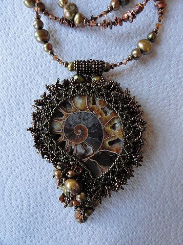Gorgeous pendant by Nora Peno, who used polymer clay to make the piece level for beading since ammonites, are NOT level. Great idea.