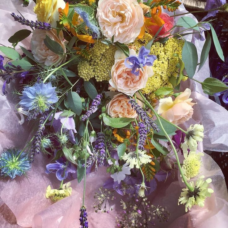 A truly organic wedding every stem picked from the family garden -this bouquet is a contemporary take on the brides grandmothers wartime shower bouquet - this time free style with clematis and  Scabiosa providing the trailing elements all tied with silk which the bride had hand dyed and which had exposures of alliums flowers and grasses decorating the delicate fabric which also lined the walk to the church as flags so looking forward to some decent pictures rather than my iPhone snaps ! It…