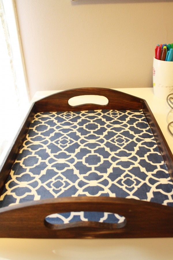 Okay I'm not sure exactly how this was done but it would be very easy. Find a serving tray cheap at a thrift store and then either buy wall paper, that sticky stuff at dollar stores for the inside of your drawers or simply glue  paper inside using wood glue and spray it with some clear coat paint.  Yea please.