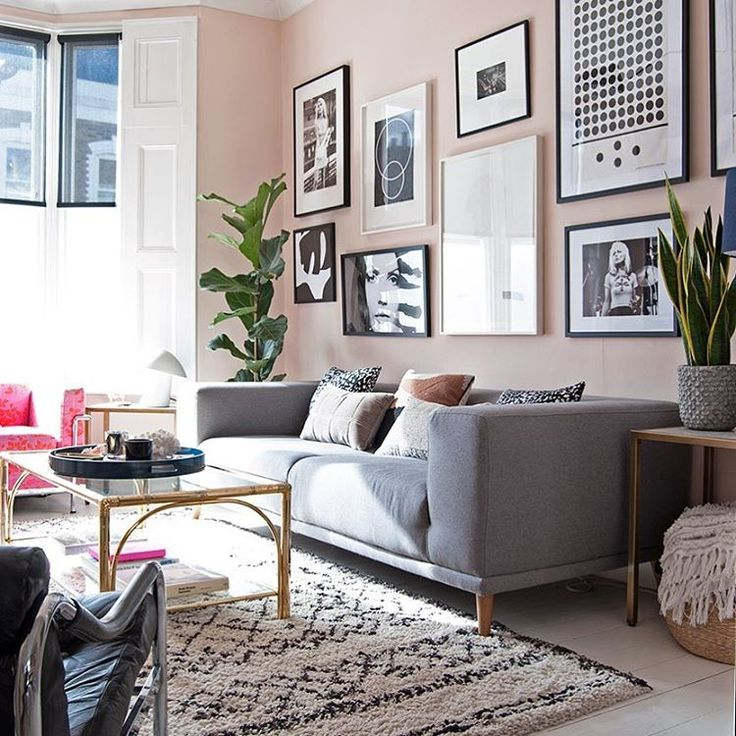 Contemporary living room with grey sofa, blush walls and Beni Ourain style rug. Wall colour Pink Ground by Farrow & Ball