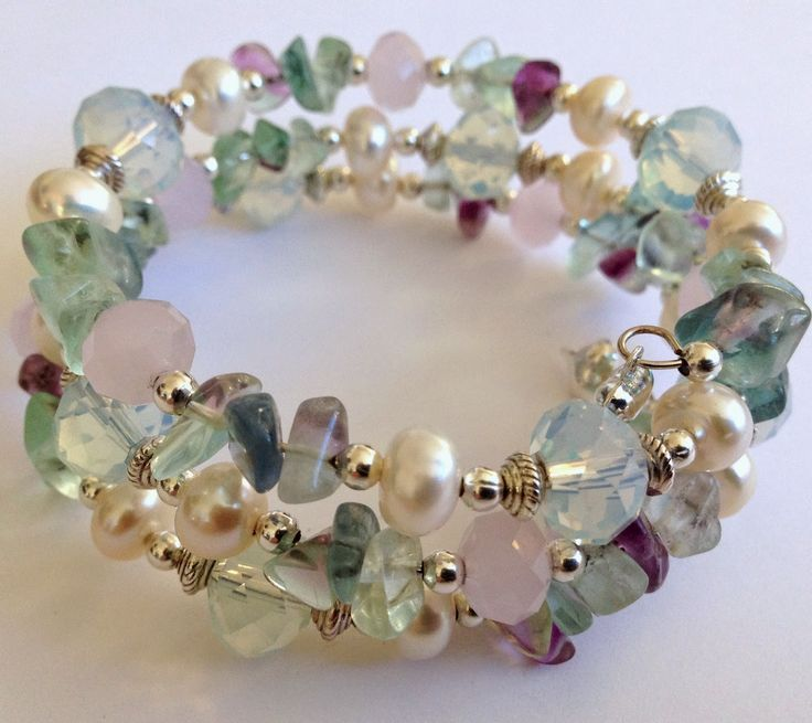 LOVE! this mixture...Rainbow Flourite Chips, 10mm White Opal Faceted Rondelle Crystals, 8mm Pink Opal Faceted Rondelle Crystals, 7-8mm Ivory White Rodelle Fresh Water Pearls, Silver Plated spacer beads.