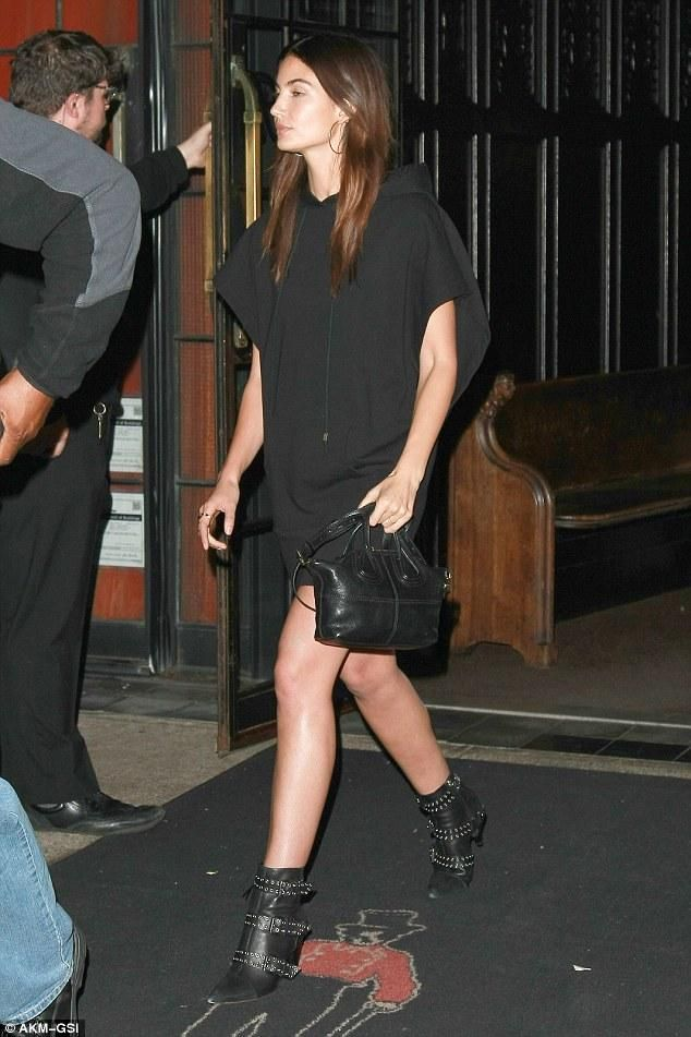 Lily Aldridge wearing Jennifer Fisher Silver-Plated Hoop Earrings, Bvlgari B.Zero1 Four Band Ring in 18 Kt Pink White and Yellow Gold, Givenchy Micro Nightingale Bag in Black Leather, Isabel Marant Lysett Buckled Leather and Suede Boots Black and Alexandre Vauthier Hooded Mini Dress as Seen on Lily Aldridge