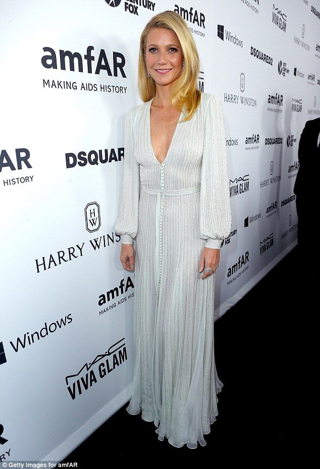 Stunning in silver: Gwyneth Paltrow leads the stars on the amFAR red carpet as they honor Ryan Murphy at American Horror Story themed night in Los Angeles on Thursday