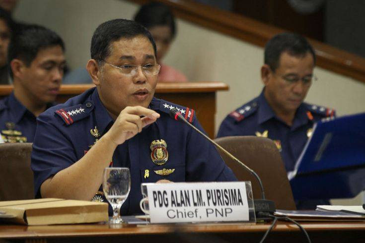 Philippine National Police (PNP) Chief Director General Alan Purisima testifies before the Senate on Tuesday. Purisima, who is facing two plunder and graft complaints, answered questions about his personal properties in Nueva Ecija and the construction of the PNP chief's residence in Camp Crame.