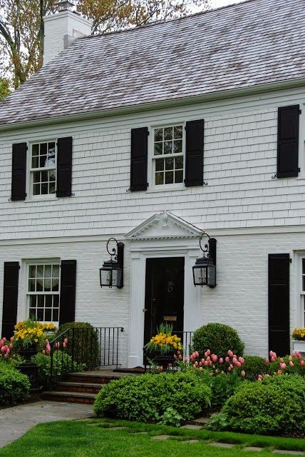 Painted brick and shingle, broken pediment with urn and dentil molding. Description from pinterest.com. I searched for this on bing.com/images