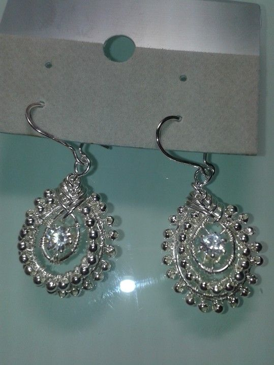 Sterling silver and cubic zirconia earrings, from a tutorial by Corra Liew. http://jewelry.de-cors.com/