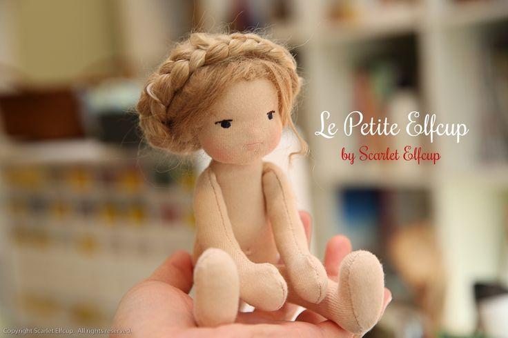 small beautiful waldorf doll