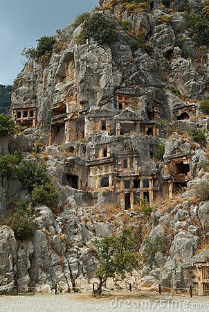 Tombs carved into the side of a cliff, overlooking the ruins of the ancient city of Myra, Turkey