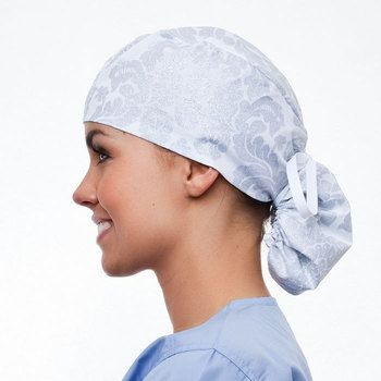 If you like print scrub tops, then the blue sky scrubs Quartz Ponytail hat is perfect for you. A brocade damask pattern enriches a white background with silver glitter and a sprinkle of joy on this elegant scrub hat.