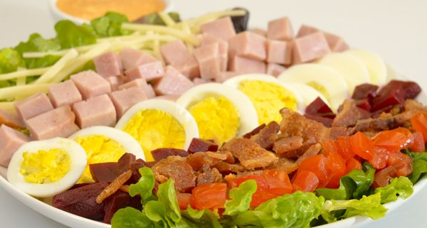 Clubhouse Salad - Wilson™ Smoked Virginia Ham is blended with mixed greens, smoky bacon, Swiss cheese, tomato, roasted beets, and finely chopped egg to create a classic, signature salad. Don't forget the Thousand Island dressing.