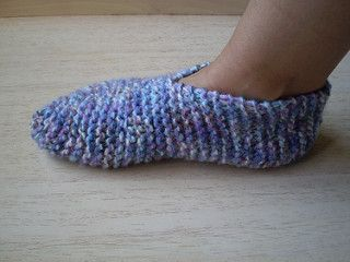 These garter stitch slippers are simple and quick to knit and will stretch to fit most adult feet. They are knitted in one piece with just two seams to sew and are really warm.