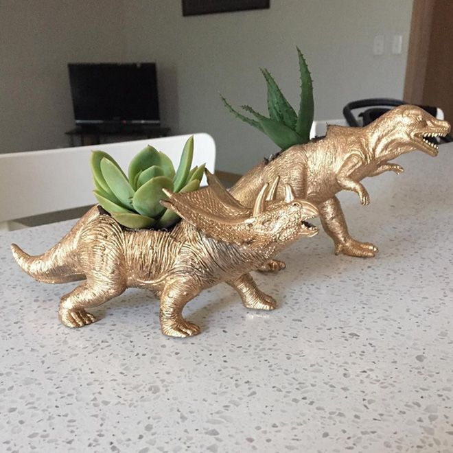 Simply pick up a plastic dinosaur or two from your local Kmart, cut out a hole in the top and spray paint that prehistoric baby gold. Voila! Instant cool dinosaur planter!