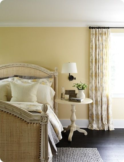 Light yellow with patterned yellow curtains. Maybe yellow at headboard wall and light cream elsewhere to allow curtains to stand out