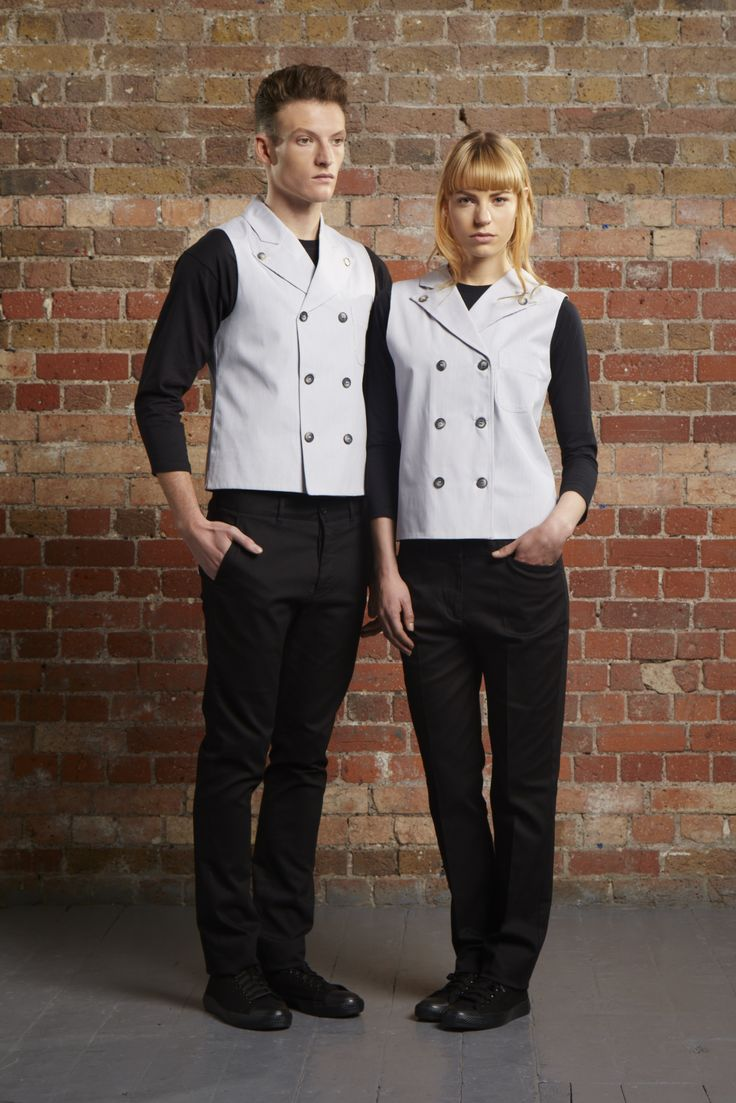 @uniformstudiouk bespoke uniform for Drake & Morgan, Kings Cross. Our brief for the waitstaff uniform was modern and clean, but eye-catching. For the waitresses we created a sculptured dress that had a clear, but unusual seam and hemlines. For the men and bar staff, a double-breasted waistcoat with a jacket fit in light cotton pin stripe fabric paired with straight leg chinos and a simple crew neck t-shirt.