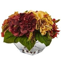 "Autumn Hydrangea Berry w/Vase #4897   Here's a wonderful piece of décor that you'll be turning to year after year. The full hydrangea blooms are forever captured in full ""Fall Glory"", sitting proudly on a bed of green leaves. The included vase is stunning in its own right, making this not only a wonderful piece to bring out every Autumn, but also makes it the perfect gift as well. Specifications: Height: 10 in, Width: 15 in, Depth: 14 in, Vase: W: 7.75 In, H: 4 In"