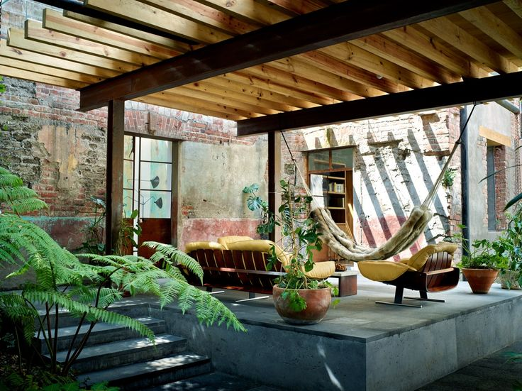 #modern #vintage #terrace with seating area under the #pergola #concrete floor #hammock