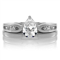 Pear-shaped 1.25 carat CZ solitaire wedding ring set. Smaller stones extend partially down the shaft of the engagement ring. Wedding band fits snugly against its mate. Nickle-free silver electroplated with rhodium to give a platinum appearance.