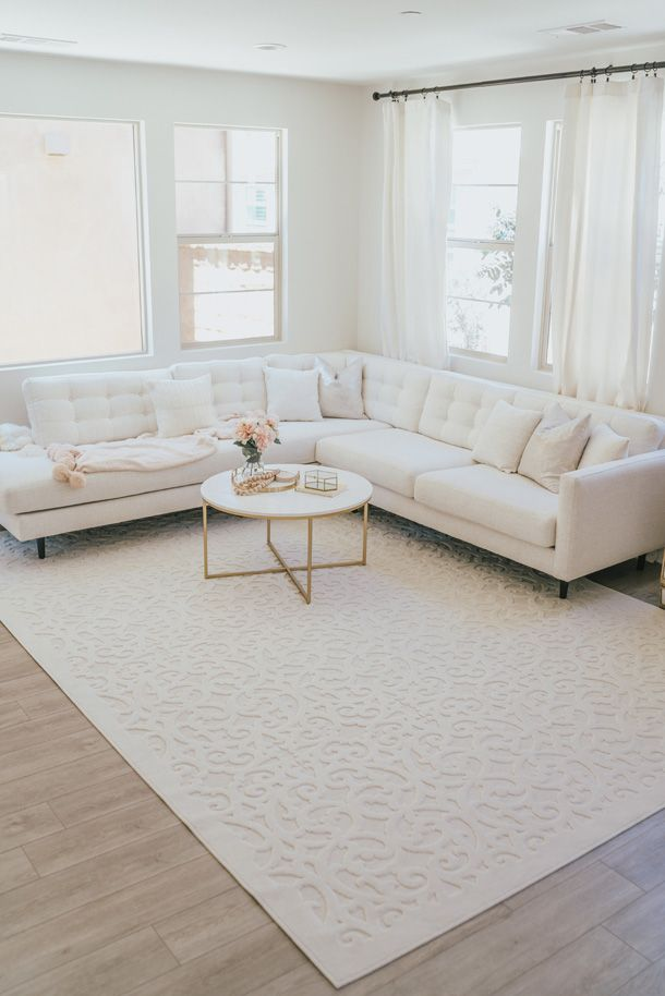 The Perfect Area Rug For A Neutral Living Room A Touch Of Pink Neutral Living Room Family Room Rug Rugs In Living Room