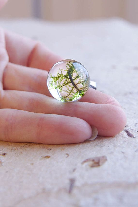 Mysterious necklace with real moss encased in crystal clear resin sphere. This small piece of nature could be a very unique and special gift. The moss