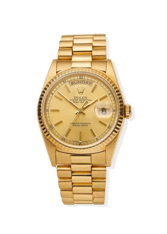 A Gentleman's gold President Day-Date wristwatch, Rolex, circa 1993. Automatic. 36mm. Ref: 18238. Cal.3155. Serial number S813540. Gold dial with applied baton numerals and luminous dots, fluted bezel, centre sweep seconds, day aperture at 12 and date aperture at 3 o'clock.Case, dial, and movement signed. Original President bracelet numbered 8385. Punched papers. - Price Estimate: $13000 - $16000