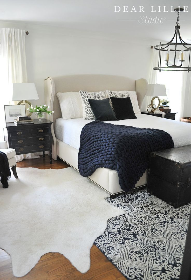Navy and Cream knit pillows like these ones from HomeGoods add a cozy touch to this master bedroom. (sponsored pin)