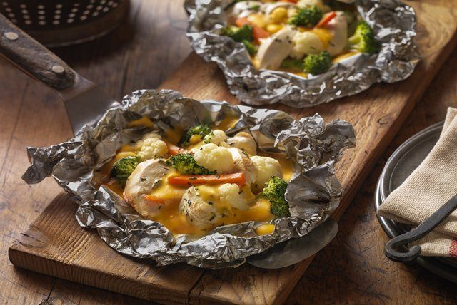VELVEETA® Italian-Seasoned Chicken Campfire Packs - 1 lb. boneless skinless chicken breasts, cut into1/2-inch-thick slices 2 tsp. Italian seasoning 1 pkg. (16 oz.) frozen broccoli, cauliflower and carrot blend, thawed, drained 1/4 lb. (4 oz.) VELVEETA, cut into 1/2-inch cubes Spray 4 large sheets of heavy-duty foil with cooking spray; top with chicken, Italian seasoning and vegetables. Fold to make 4 packets.Grill 15 min. or until chicken is done. Cut slits in foil to release steam…