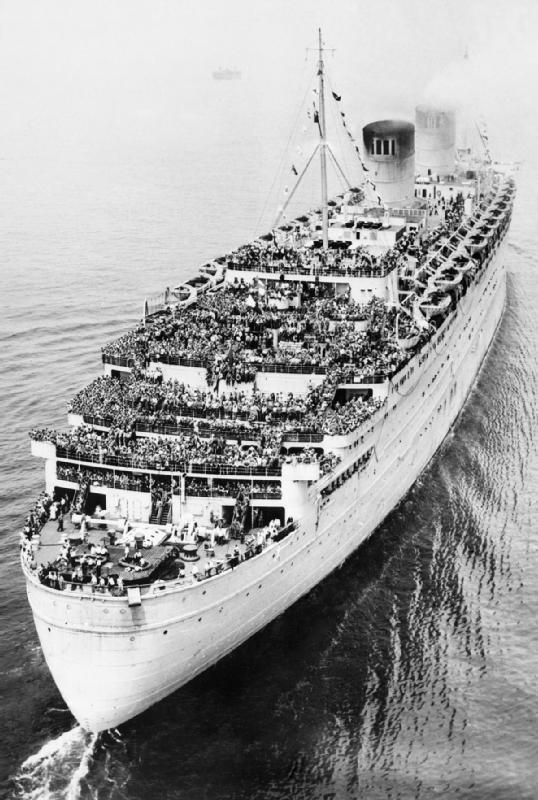With her decks crowded with 12,000 returning US servicemen, the transatlantic liner RMS Queen Elizabeth steams into New York Harbor sometime in 1945.