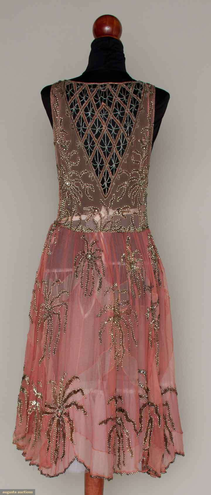 PINK & SILVER BEADED PARTY DRESS, MID 1920sPale pink chiffon w/ darker pink large fan shape inserts, silver glass, sequin & rhinestone multi-petal blossoms, beaded lattice inserts on F & B bodice, full skirt & scalloped hem. Back