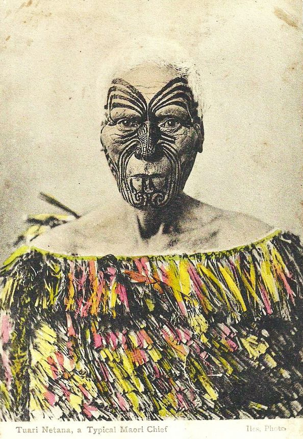 "From a hand-coloured card from the late 1800's, the caption reads ""Tuari Netana, a Typical Maori Chief"" under the picture of a handsome elder with a tattooed face."