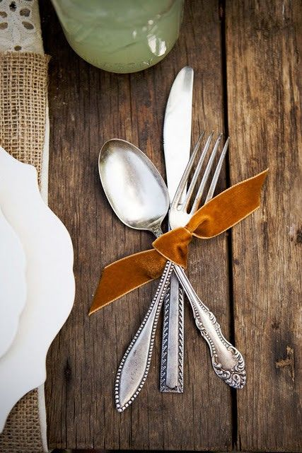Thanksgiving place setting idea - love the mixed patterns on the flatware and the crisp velvet ribbon