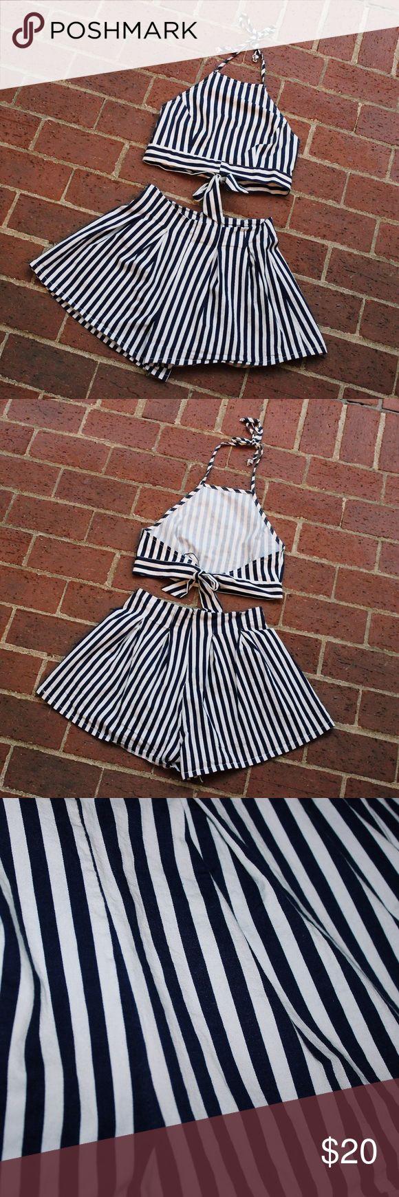 Navy Blue and White Stripped Two Piece Set This two piece set (shorts and top) is great for a casual outfit or add heels to go out on the town! This playsuit has navy blue and white stripes. The top is very adjustable with ties. Only worn once! Other