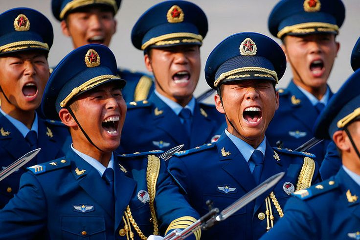 Honor guard soldiers in the Chinese People's Liberation Army (PLA) shout as they march during a welcoming ceremony for Kuwait's Prime Minister Sheikh Jaber al-Mubarak al-Sabah at the Great Hall of the People in Beijing.