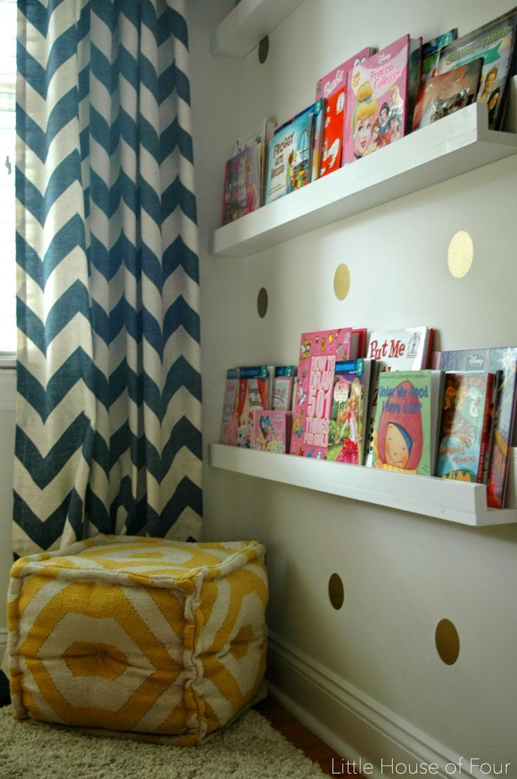 A beautiful navy, coral and yellow room makeover with custom built wood shelves.