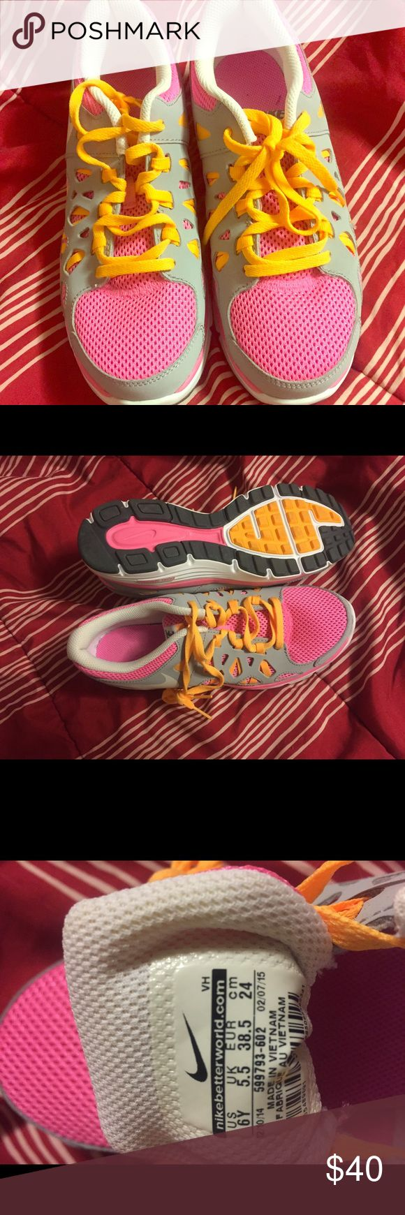 Nike Dual Fusion Run 2 sneakers size 6Y Brand new sneakers. Never worn. Pink, orange and gray Nike Dual Fusion sneakers. Size 6Y Nike Shoes Sneakers