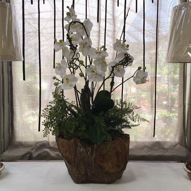 Custom arrangement with permanent orchids and greenery. #arrangementsbyamanda