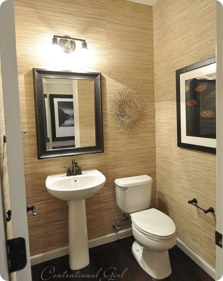I am not a fan of wallpaper, but this grasscloth wallpaper had me at hello. Very sleek and modern bath.