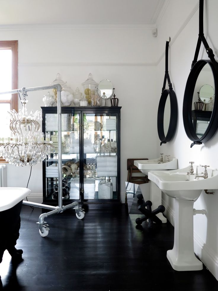 pictures to hang in master bathroom%0A Love the hanging mirrors  sinks  tub  and dark floors