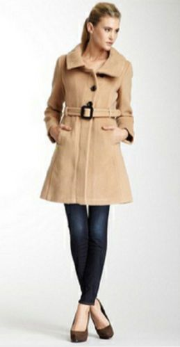 Soia & Kyo Autumn Belted Coat Color Camel Size XL  Sale $189.00. Soia & Kyo is known for its fabulous fit and detailing.  This gorgeous wool-blend 3/4 walking coat has extraordinary styling. The front camel colored ribbed wool-blend coat has an asymmetrical front cut and is fully lined in lovely gold fabric.Not only are these coats incredibly stylish, but they are incredibly warm as well. The perfect coat for any occasion.