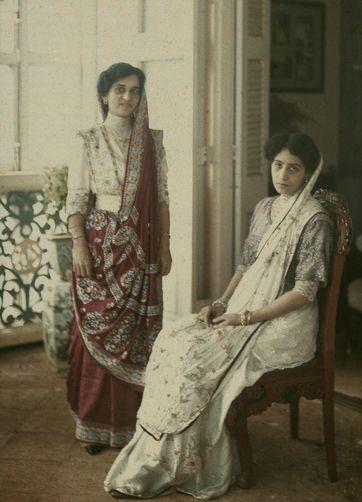 Parsee ladies in Victorian-inspired saris