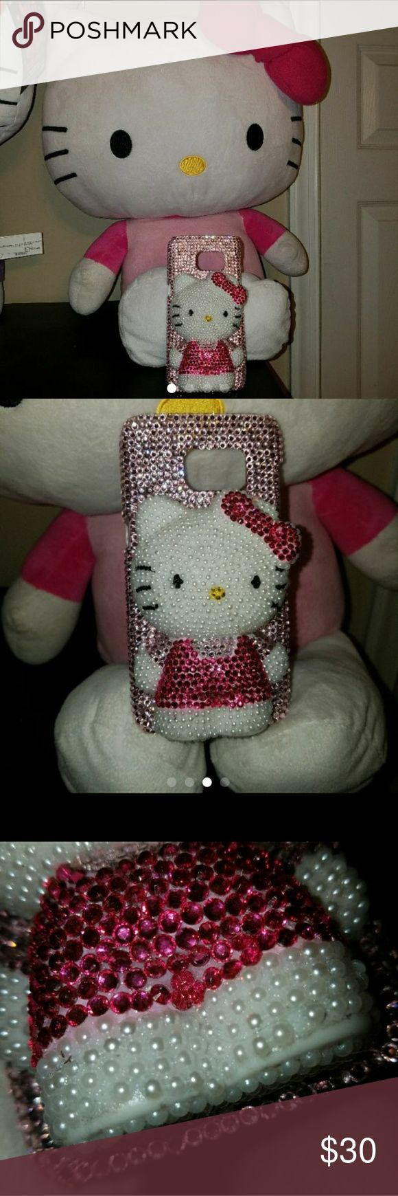 HELLO KITTY Samsung Galaxy S7  Phone Case Beautiful phone case. Lightly used, some wear and missing pearls along the bottom of her feet. Lots of bling and pearls! :) It's like 3D, so it's bulky. It's very cute tho. It just took up too much room in my small bag. BRAND is Not Hello Kitty,  just posting for exposure. Accessories Phone Cases