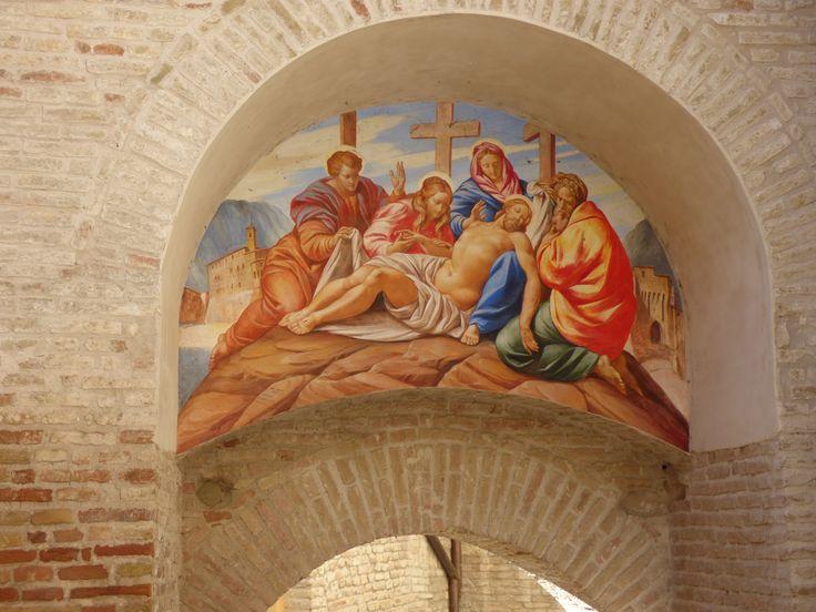 Porta della Croce, cross gate, inside door (13th century). The deposition is contemporary. The original fresco dating 17th century was detached and located in the Chiesa di Santa Croce.