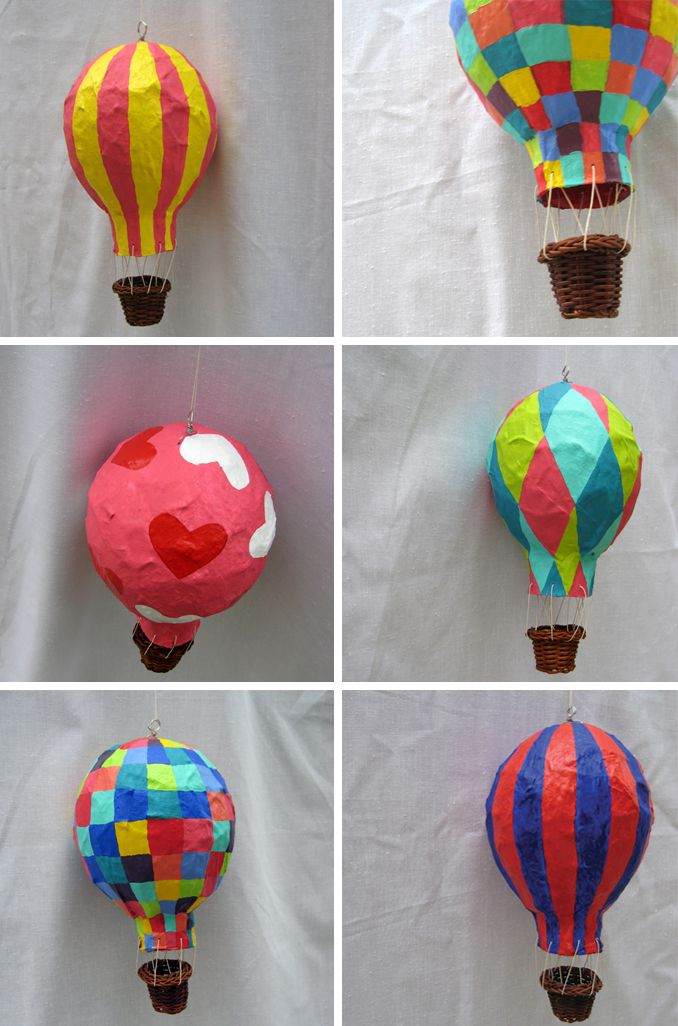 Paper mache a balloon, pop the balloon, add string and a basket!  Love these!