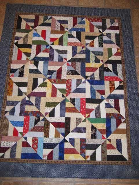 Oooo, I love the way it fools your eye with movement! It's the fabric values and strip placement.This quilt is SO EASY!