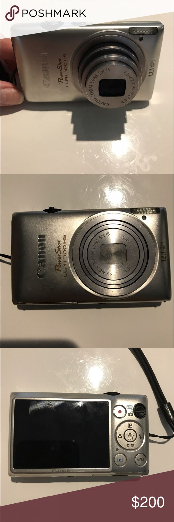 Canon Powershot ELPH-300 HS 12.1 MP Digital Camera Worlds thinnest digital camera! Great working condition with no major flaws. Comes with extra battery and camera case. Needs memory card Other