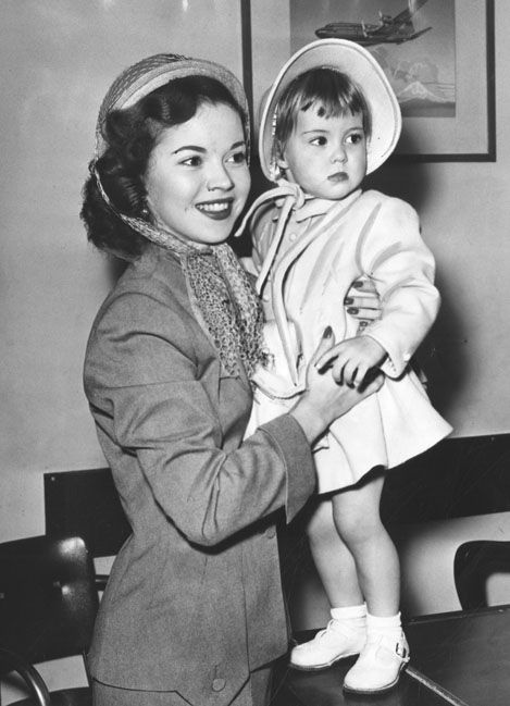 """""""Linda Susan Agar, Shirley Temple's daughter, just turned 2 and her gift is a Hawaii trip. Mother and daughter are leaving today for a threeweek jaunt.""""  Press Photograph dated January 30, 1950."""
