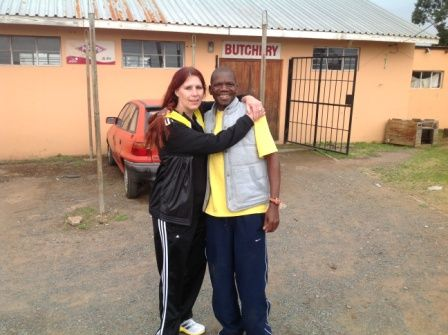 Willi Mtolo, ambassador for #MandelaMarathon, at his butchery.   At this point the athletes will turn left towards Hilton, here with Donnette Fry, #ROC Social Media photo IMG_2755.jpg