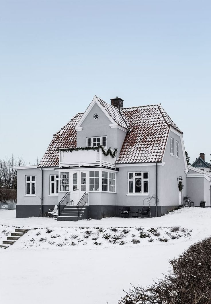 Classic house facade in grey, black and white colors.