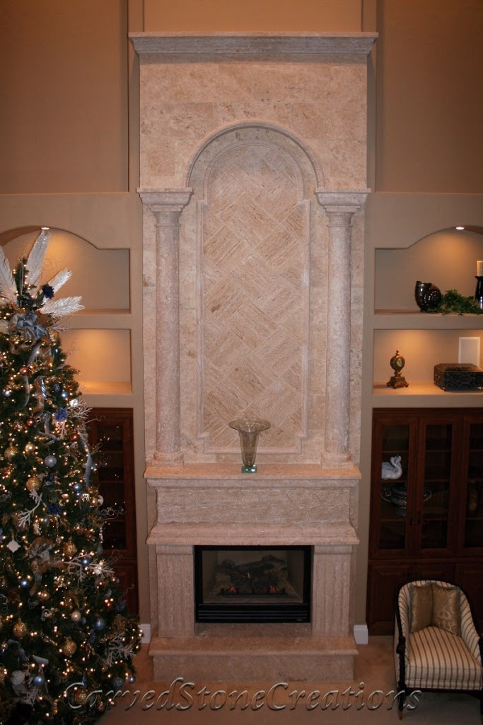 This beautiful 2 story travertine fireplace by carved for Rock chimney designs