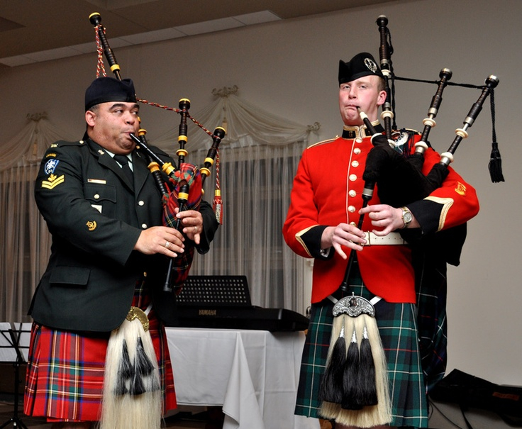 Master Corporal (MCpl) McCarthy of the Black Watch and 25859 Officer Cadet (II Year) Ben Deutsch of RMC of Canada (RMCC) were present to give a live bagpipe performance at the second annual Robbie Burns Dinner hosted at Royal Military College Saint-Jean (RMCSJ).    Photo credit: Marie-Claude Leblanc